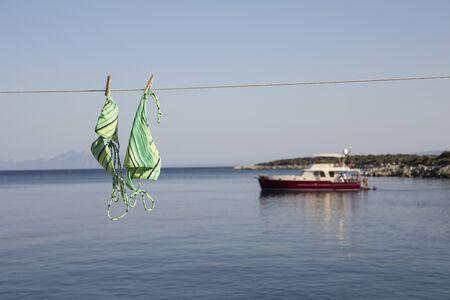View Of Bikini Hanging On Clothes Line And  Sea, Cappadocia, Anatolia, Turkey