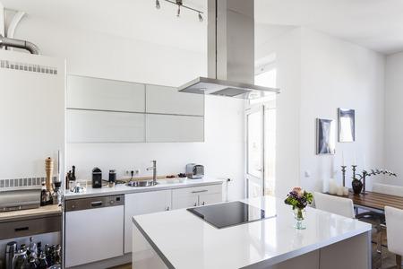 Modern White Coloured Kitchen With Kitchen Island Stock Photo
