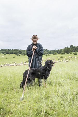 Portrait Of Farmer And Sheepdog