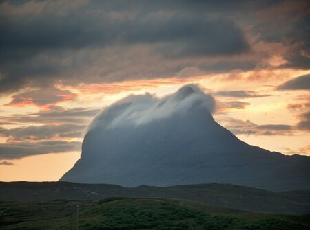 Low Cloud Rolling Over Top Of Stac Pollaidh Mountain At Dusk, Assynt, Scotland, Uk