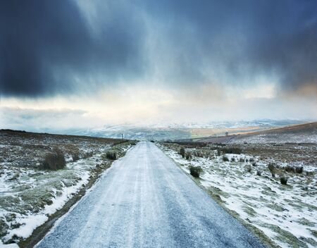 Icy Rural Road With Storm Clouds Ahead, Swaledale, Yorkshire, Uk