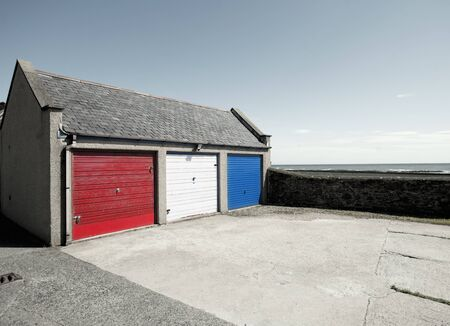 Garage Doors Painted Red, White And Blue, Johnshaven, Aberdeenshire, Scotland, Uk