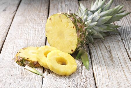Pineapple Rings And Pineapple On Whitewashed Wooden Table