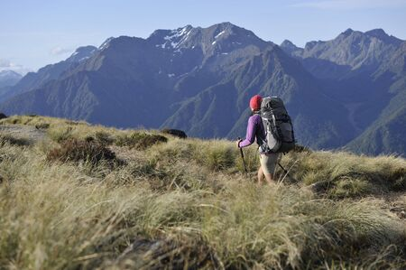 Young Female Hiker Hiking The Kepler Track, New Zealand