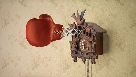 Red Boxing Glove Attached To Cuckoo Clock Spring