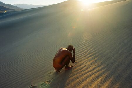 Nude Woman Cowering In Desert