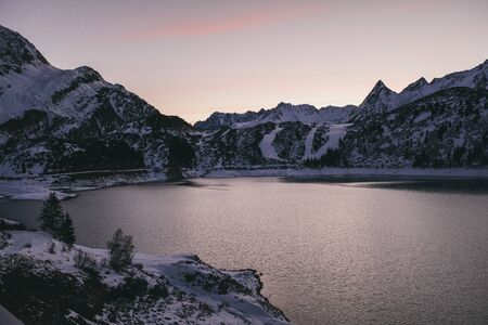 Kops Reservoir And Snow Covered Mountain Range, Evening, Galtur, Austria