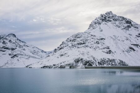 Silvretta Reservoir And Snow Covered Mountain Range, Galtur, Austria Imagens