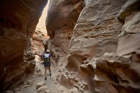 Hiker Exploring Little Wild Horse And Bell Canyon Loop, Goblin Valley State Park, San Rafael Swell, Utah