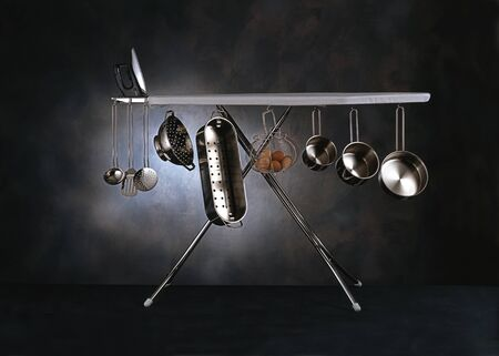 Kitchen Utensils Hanging From Ironing Board