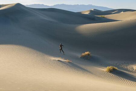 Nude Woman In Desert Running Up Dune