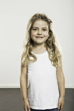 Studio Portrait Of Cute Girl With Long Blond Hair