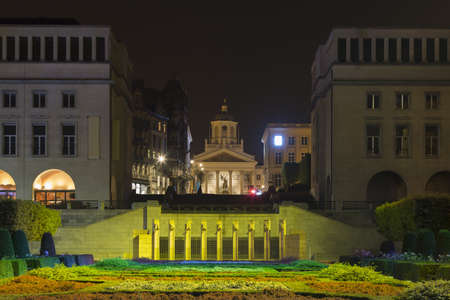 View Of Mont Des Arts Garden To Saint Jacques-Sur-Coudenberg On Place Royale At Night, Brussels, Belgium