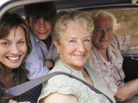 grand sons: Multi-generational family sitting in car, smiling, portrait LANG_EVOIMAGES