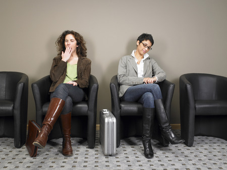 Two businesswomen sitting in waiting room. Brussels, Belgium. LANG_EVOIMAGES