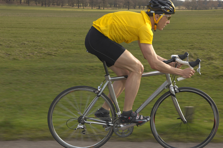 Man cycling in park LANG_EVOIMAGES