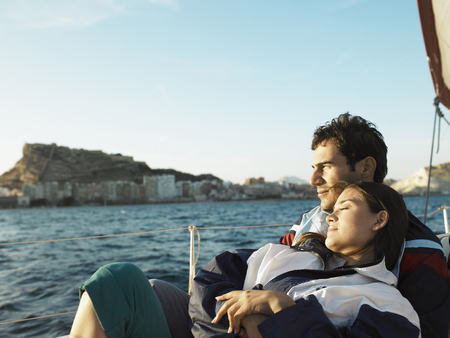 passtime: Young couple on yacht, sitting, portrait LANG_EVOIMAGES