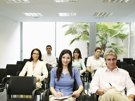 Colleagues watching presentation, portrait