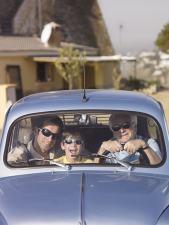family unit: Boy (8-10) in sunglasses sitting in car with father and grandfather, portrait LANG_EVOIMAGES