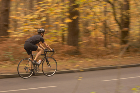 differential: Man cycling in Autumn woods