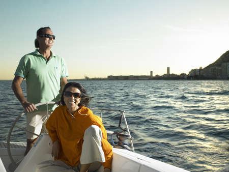 50 something: Mature couple relaxing on yacht, smiling