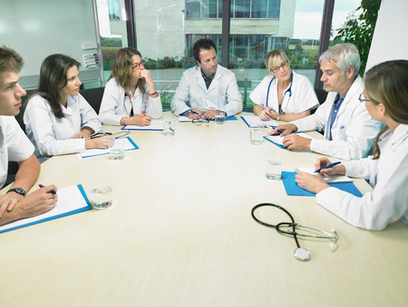 co: Group of doctors meeting in conference room.