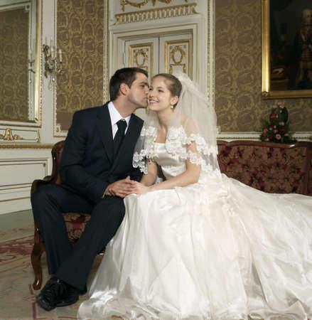 enjoys: Groom kissing the bride, smiling