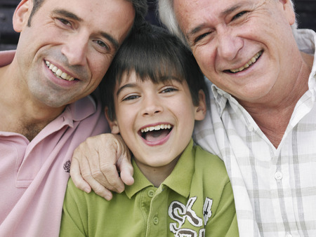 50 something: Boy (8-10) sitting with father and grandfather, smiling, close-up, portrait LANG_EVOIMAGES