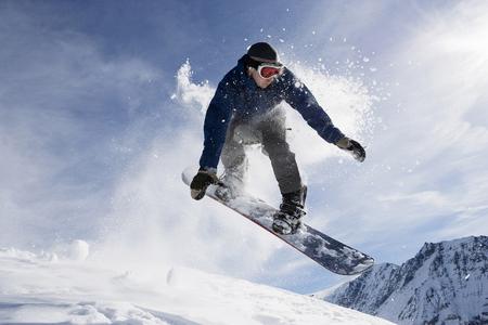 cirrus: Male snowboarding on mountain, action shot