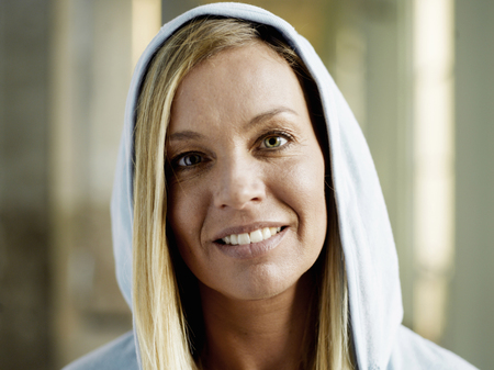 Woman wearing hooded top, smiling, portrait, close-up