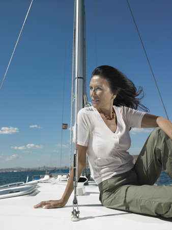 captivated: Mature woman relaxing on yacht LANG_EVOIMAGES