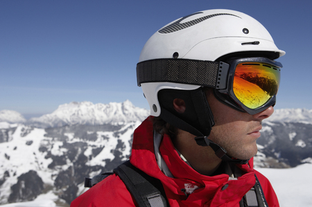 passtime: Austria, Saalbach, male skier wearing helmet and goggles, close-up