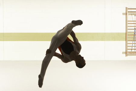 Male gymnast performing floor exercise