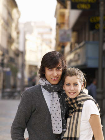 passtime: Young couple standing in street, smiling, portrait