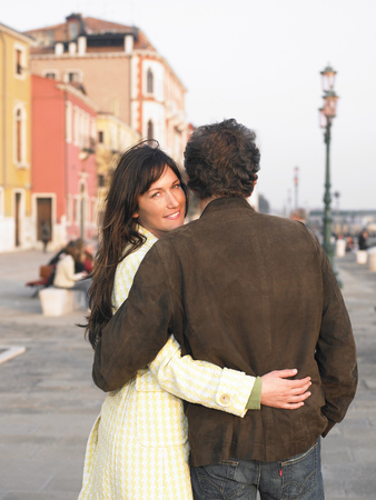 appearance: Italy, Venice, couple walking, woman smiling