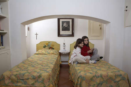 enjoys: Girls (6-11) in bedroom wearing headphones