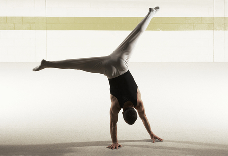 Male gymnast performing floor exercise, rear view LANG_EVOIMAGES