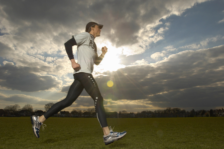 Man runner in park, low angle view (sun flare) LANG_EVOIMAGES