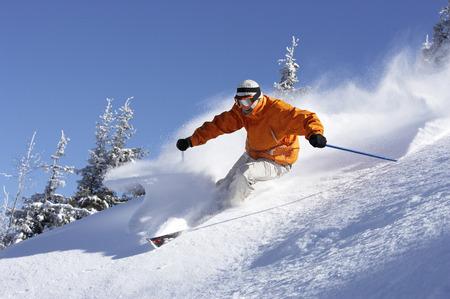 Austria, Saalbach, man skiing down slope