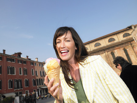 thirtysomething: Woman eating ice cream. Venice, Italy.