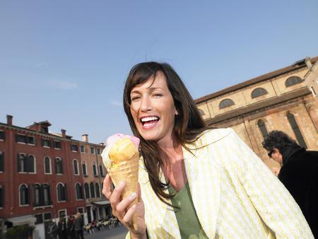 appearance: Woman eating ice cream. Venice, Italy.