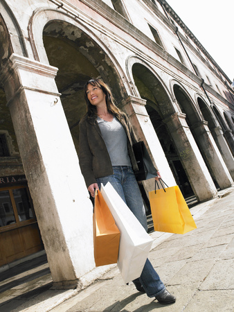 shadowed: Woman carrying shopping bags. Rialto, Venice, Italy. LANG_EVOIMAGES