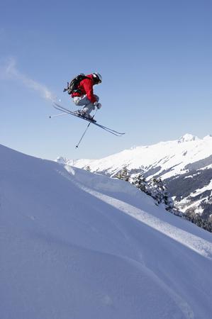 mountainous: Austria, Saalbach, male skier jumping down slope
