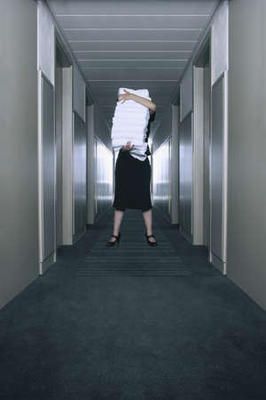 woman in bath: Housekeeper carrying a stack of towels LANG_EVOIMAGES