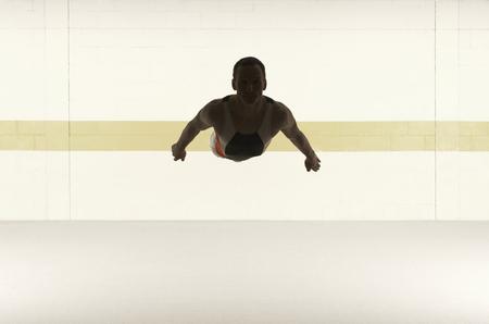 somersault: Male gymnast performing somersault in floor exercise