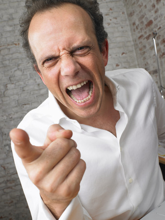 Businessman pointing and shouting at camera. ,Brussels, Belgium. LANG_EVOIMAGES