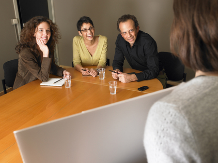 encounters: Woman giving presentation in business meeting. Brussels, Belgium.
