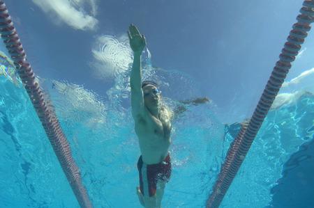 passtime: man swimming in pool