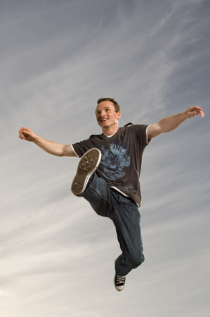 Man leaping through the air LANG_EVOIMAGES