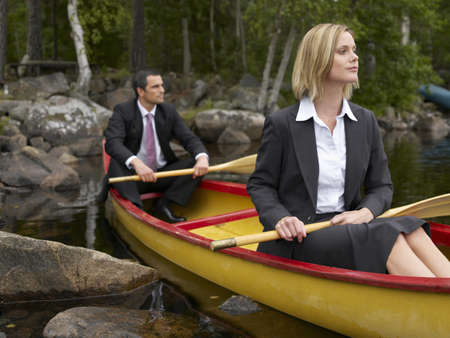 two persons only: Business couple in a kayak LANG_EVOIMAGES